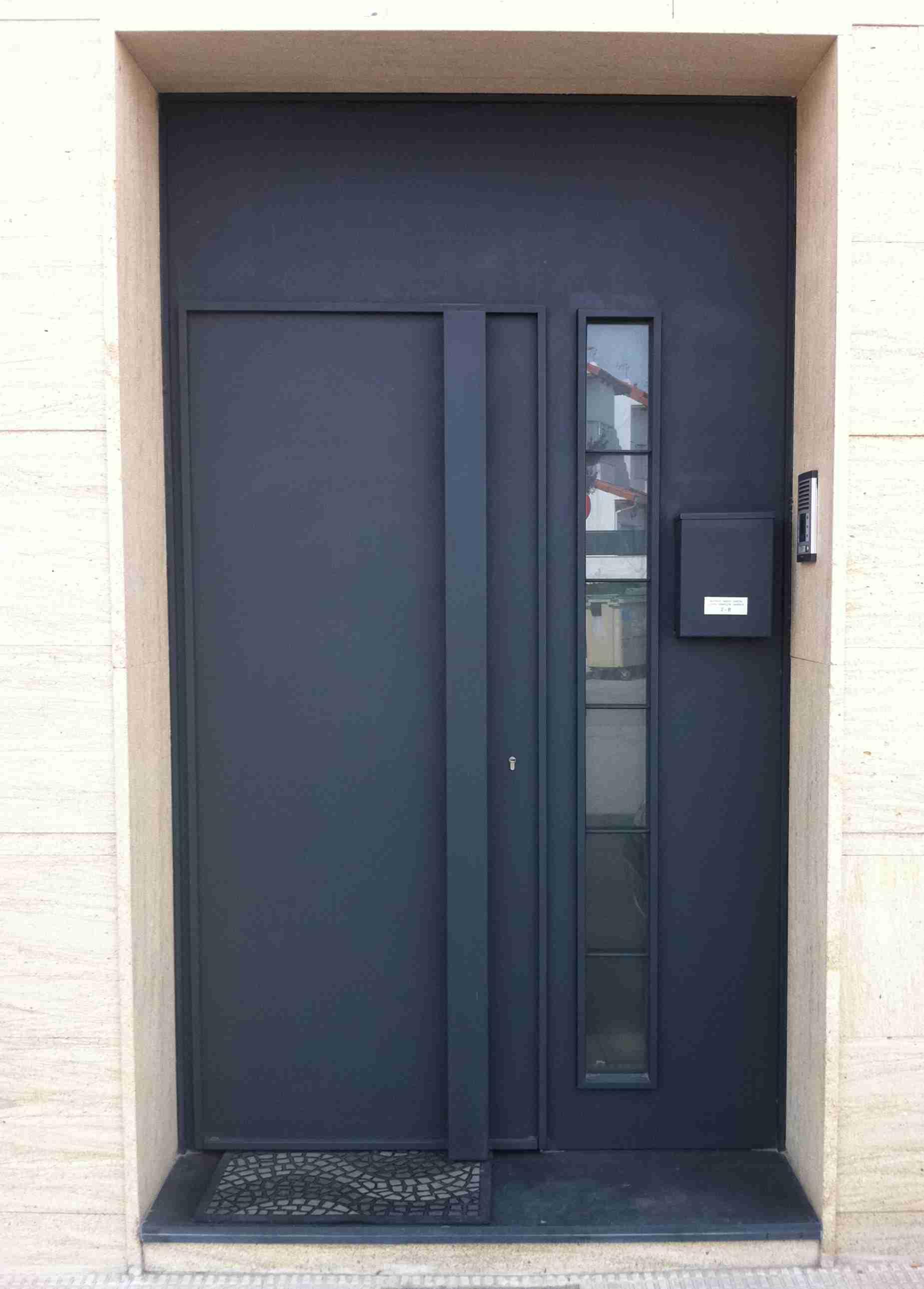Puertas modernas puerta de entrada con estilo moderno y for Modelos de puertas para casas modernas